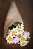 Small bouquet of wildflowers on a rustic table Stock Image