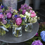 Small bouquets of lilacs, hyacinths, anemones, roses and peonies Royalty Free Stock Photo