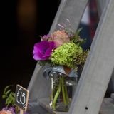Small bouquets for special occasions from tulip, anemone and hydrangeas in a can on the stairs for sale. The Small bouquets for special occasions from tulip Stock Photo