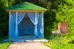 Small bower with curtains Royalty Free Stock Image