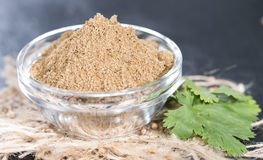 Small bowl with Cilantro Powder Stock Image
