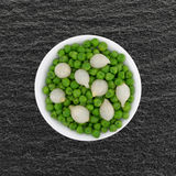 Small bowl with cooked pearl onions and green peas Royalty Free Stock Photography