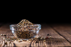 Small bowl with crushed Peppercorns royalty free stock photos