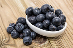 Small bowl filled with Blueberries Stock Photo