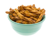 Small bowl filled with braided pretzel sticks Stock Image