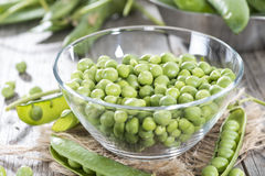 Small bowl with fresh Peas Stock Photo