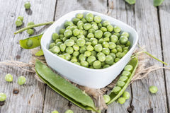 Small bowl with fresh Peas Stock Photo
