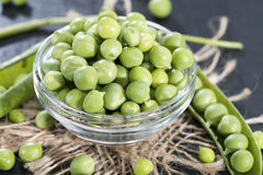 Small bowl with fresh Peas stock photos