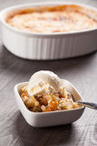 Small bowl of freshly served peach crisp with ice cream stock images