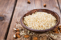 Small bowl with Minced Almonds. (close-up shot) on rustic wooden background Royalty Free Stock Image
