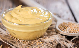 Small bowl with Mustard stock photography