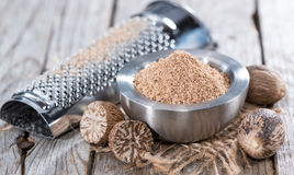 Small bowl with Nutmeg Powder. Small bowl with fresh grated Nutmeg Powder Stock Images