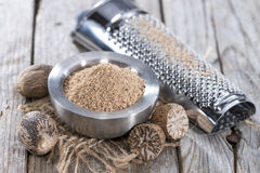 Small bowl with Nutmeg Powder. Small bowl with fresh grated Nutmeg Powder Stock Image