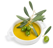 Small bowl with olive oil, decorated with a small twig with gree Stock Image