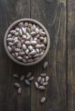 Small bowl of pistachios on wooden table Stock Photos