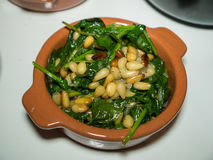 Small Bowl of Spinach with Pine Nuts stock photography