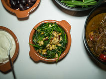 Small Bowl of Spinach with Pine Nuts Royalty Free Stock Photos