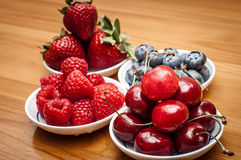 Small bowls of fruit Stock Images