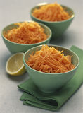 Small bowls of grated carrots Stock Photography