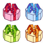 Small box. A set of four small present boxes with bands Royalty Free Stock Photos