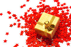Small box. Is standing on scattered ornamental star Royalty Free Stock Photo