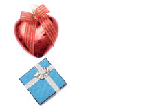 Small box for gift and christmas heart shaped red ball on white Stock Image