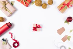 Small box with a gift and a red bow. On a white table top view Stock Image