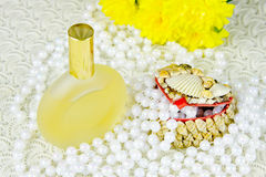 Small box, spirits and beads of pearls Stock Photo