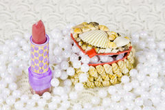 Small box, woman pomade and beads of pearls Stock Image