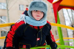 Small boy. Portrait of a boy on the street in winter clothes Stock Photography