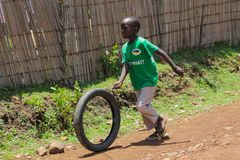Small boy in Africa playing with wheel Royalty Free Stock Photos