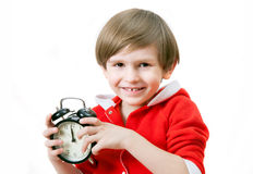 The small boy with alarm clock. In Christmas night Royalty Free Stock Photo
