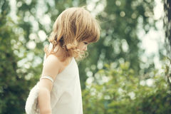 Small boy in angel wings Royalty Free Stock Images