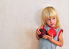 Small boy with apples Stock Photo