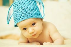 Boy baby in bunny hat royalty free stock photography