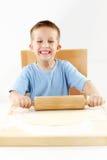 Small boy baking cookies Stock Photos