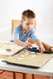 Small boy baking cookies Stock Images