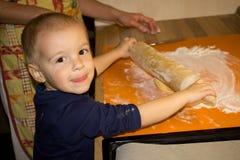 Small boy baking cookies Royalty Free Stock Photo