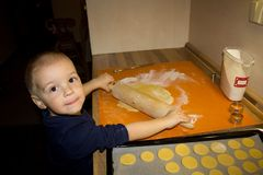 Small boy baking cookies Stock Photos