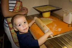 Small boy baking cookies Royalty Free Stock Image