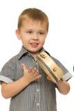 Small boy banging  tambourine Stock Photo