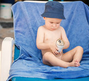 Small boy on beach chair Stock Photos