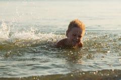 Small boy on the beach Stock Photo