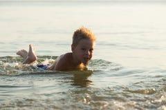 Small boy on the beach Stock Photography