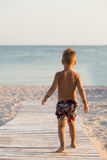 Small boy on the beach Stock Images