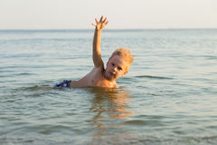 Small boy on the beach Royalty Free Stock Image