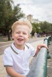 Small boy on the beach Stock Photos
