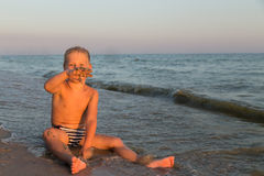 Small boy on the beach Royalty Free Stock Photos