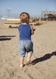 Small boy on beach Stock Photos