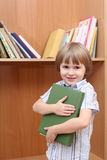 Small boy with big green book Stock Photography